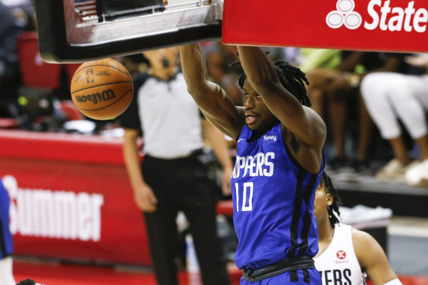 The Clippers' Daniel Oturu dunks against the Portland Trail Blazers.