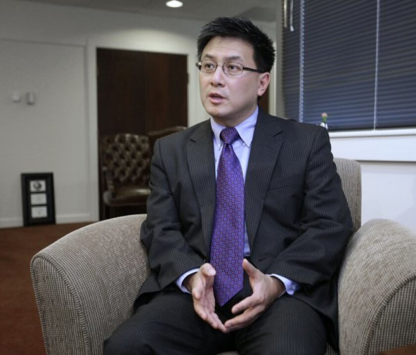 State Controller John Chiang talks with reporters in 2011.