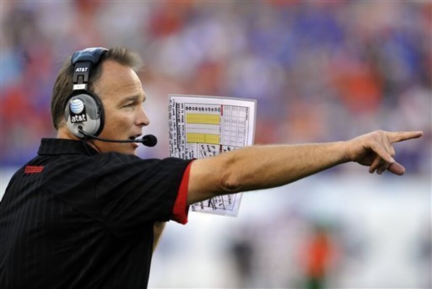 Georgia head coach Mark Richt calls a play from the sideline in the second half during an NCAA college football game against Florida Saturday, Oct. 30, 2010, in Jacksonville, Fla,. Florida defeated Georgia in overtime 34-31. (AP Photo/Stephen Morton)
