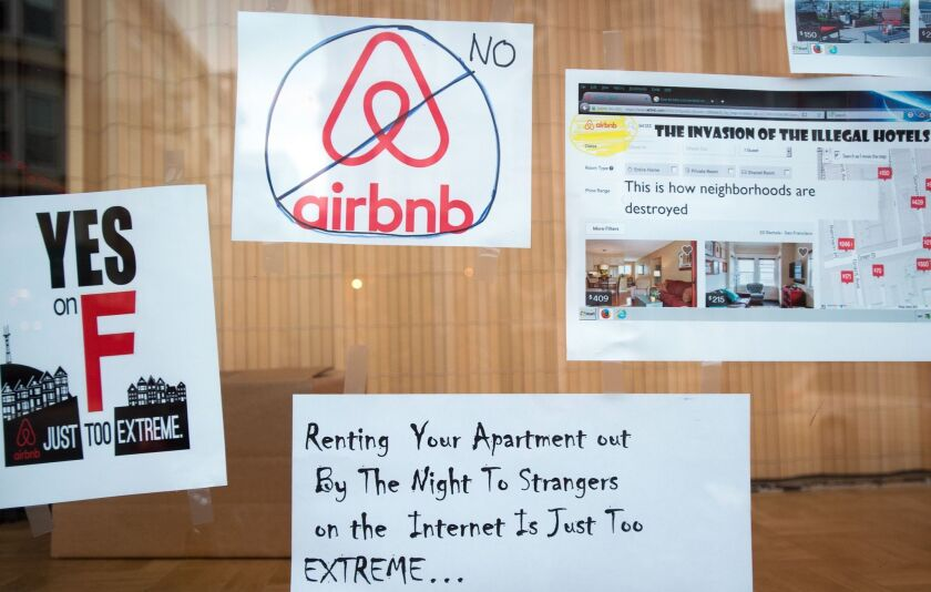 Signs showing support for Proposition F are posted on a shop window in San Francisco on Nov. 2.