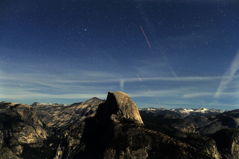 Lighted by a very bright half moon, night becomes day during this 30-second time exposure of the skies over Half Dome, as seen from Glacier Point at 9:35 p.m.