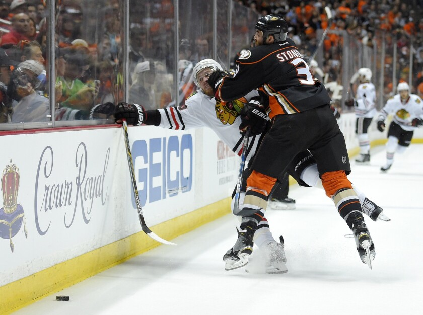 Ducks defenseman Clayton Stoner puts a hit on Blackhawks forward Bryan Bickell during the first period of Game 1.