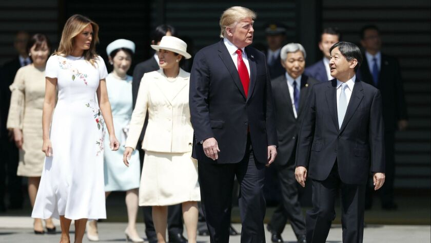 President Trump and First Lady Melania Trump are escorted by Japan's Emperor Naruhito and Empress Masako during a welcome ceremony on Monday at the Imperial Palace in Tokyo.