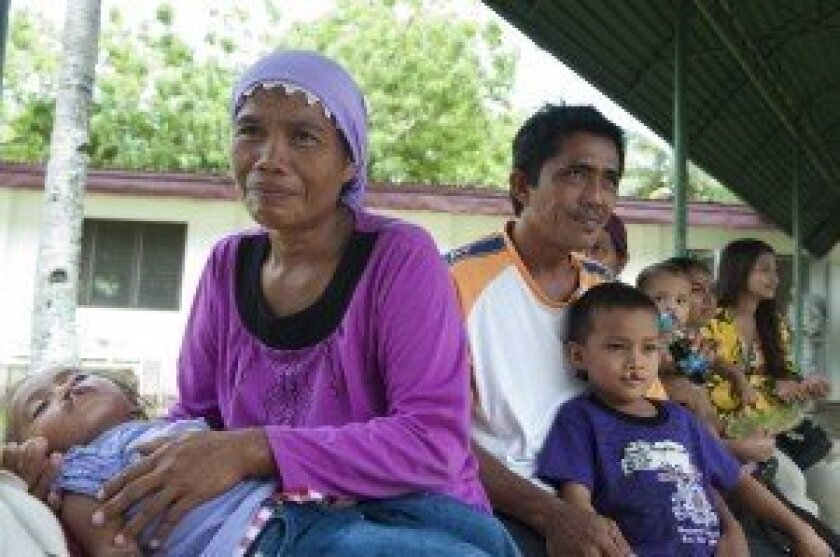 Families of cleft lip patients wait outside the operating room in the Philippines in 2011. (Courtesy of MC1 Cassandra Thompson/U.S. Navy)