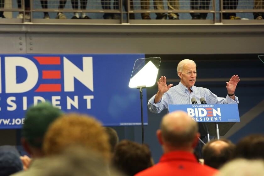 Presidential candidate Joe Biden speaks at a town hall in Manchester, N.H.