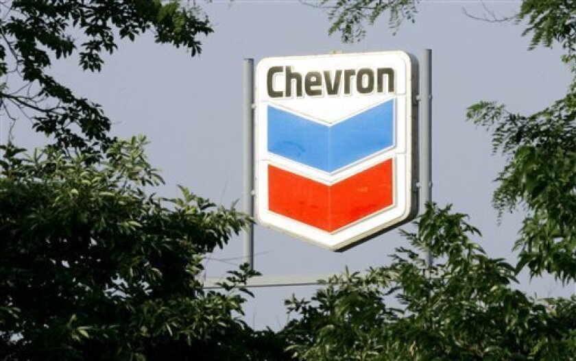 FILE - In this Aug. 1, 2008 file photo, a sign for a Chevron gasoline station is seen through trees in La Grange, Ky. Chevron Corp. said Friday, Dec. 4, 2009 it will withdraw from motor fuels operations in 13 states from Indiana to South Carolina. (AP Photo/Ed Reinke, file)