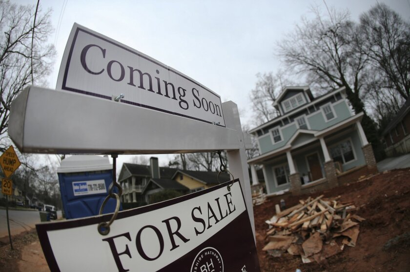 """In this Tuesday, Jan. 26, 2016, photo, a """"For Sale"""" sign hangs in front of a home under construction in Atlanta. On Wednesday, Feb. 17, 2016, the Commerce Department reports on U.S. home construction in January. (AP Photo/John Bazemore)"""
