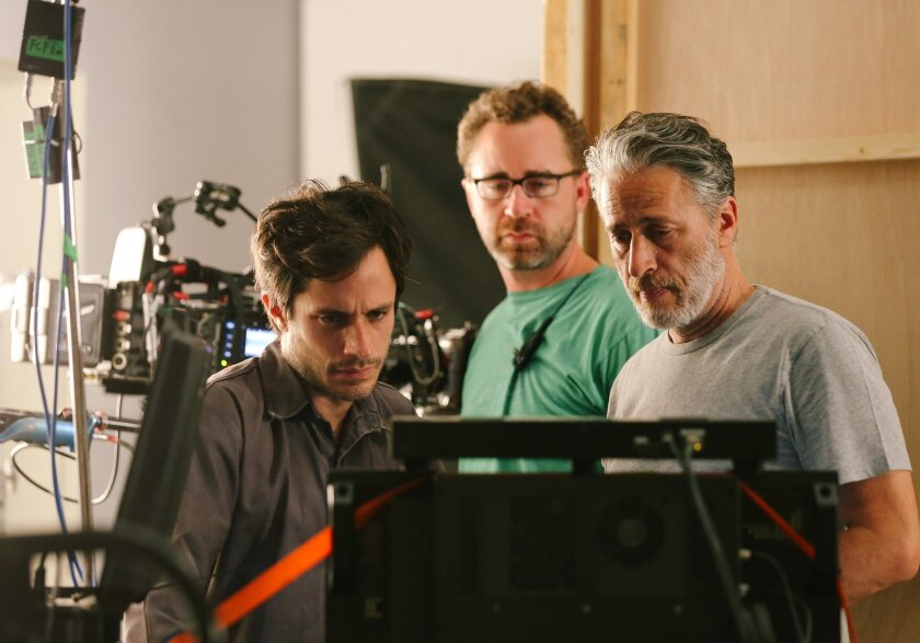 """This image released by Open Road Films shows from left, Gael Garcia Bernal, First Assistant Cameraman Michael Burke, and Jon Stewart on the set of """"Rosewater."""" (AP Photo/Open Road Films, Laith Al-Majali)"""