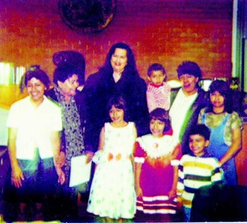 Adoption day for Edgar Jimenez Lugo and his brothers and sister in August 1997. His grandmother, Carmen Solis Gil, is second from left. Edgar is in the arms of an aunt.