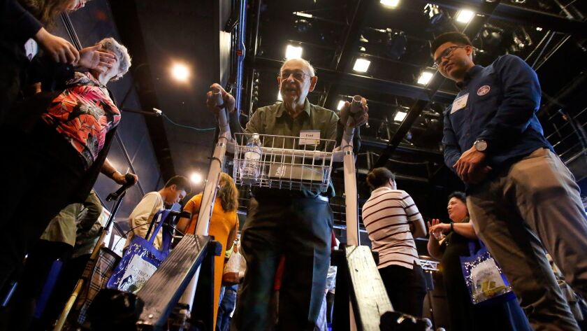 Fred Daniel tests out the IndeGo, a shopping cart-style walker, at UCSD's Design Competition Showcase on June 10. Daniel was one of 20 Carlsbad seniors who consulted with the engineering students on new products for seniors.