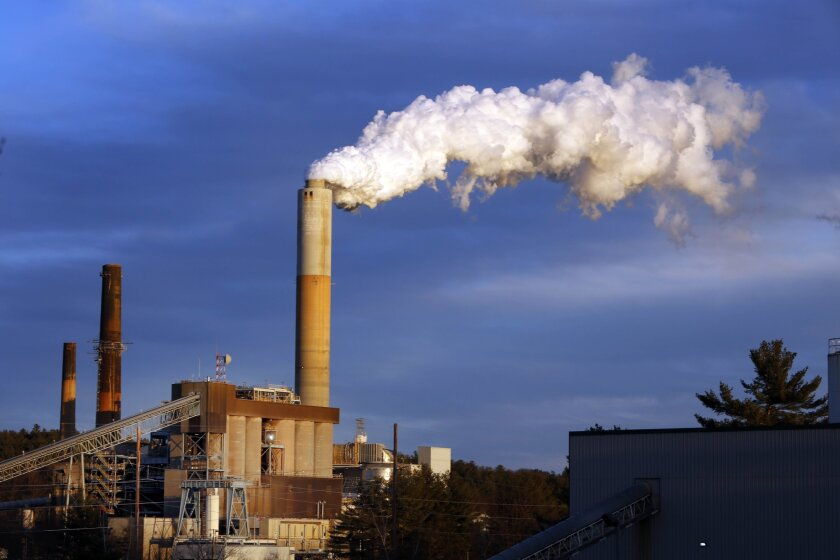 Steam billows from the coal-fired Merrimack Station in Bow, N.H. The Obama administration's proposed rules for power plants face an early court challenge.