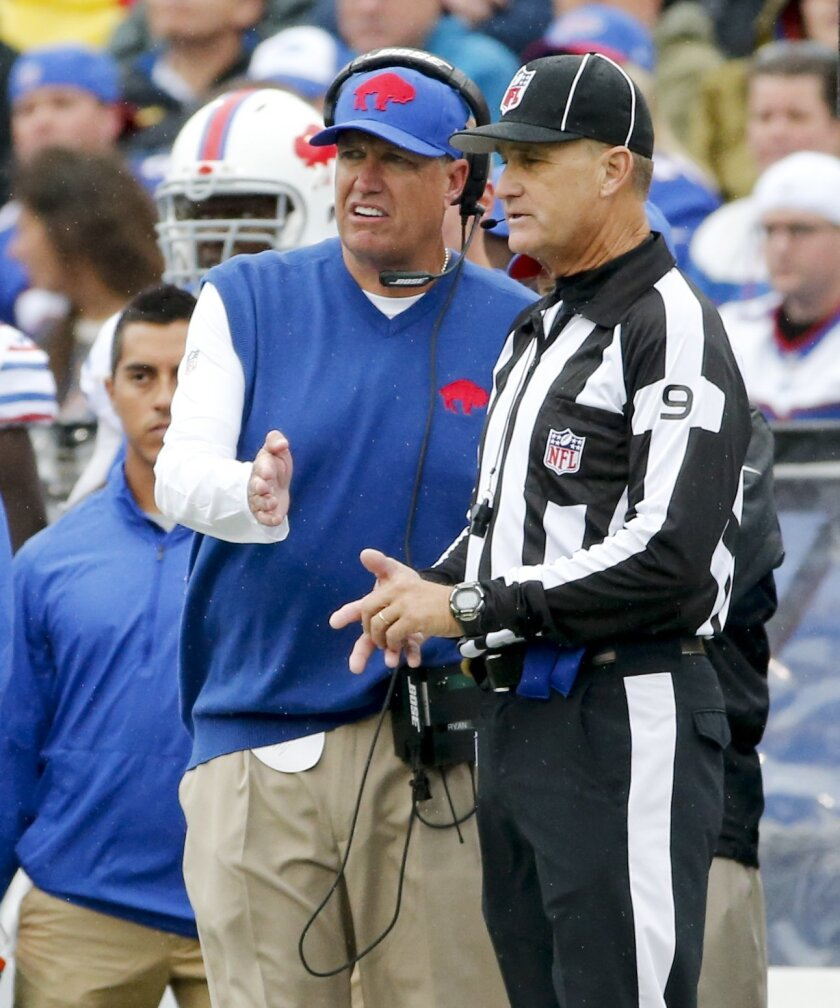 Buffalo Bills head coach Rex Ryan, left, talks with line judge Mark Perlman, right, during the first half of an NFL football game against the Indianapolis Colts, Sunday, Sept. 13, 2015, in Orchard Park, N.Y. (AP Photo/Bill Wippert)