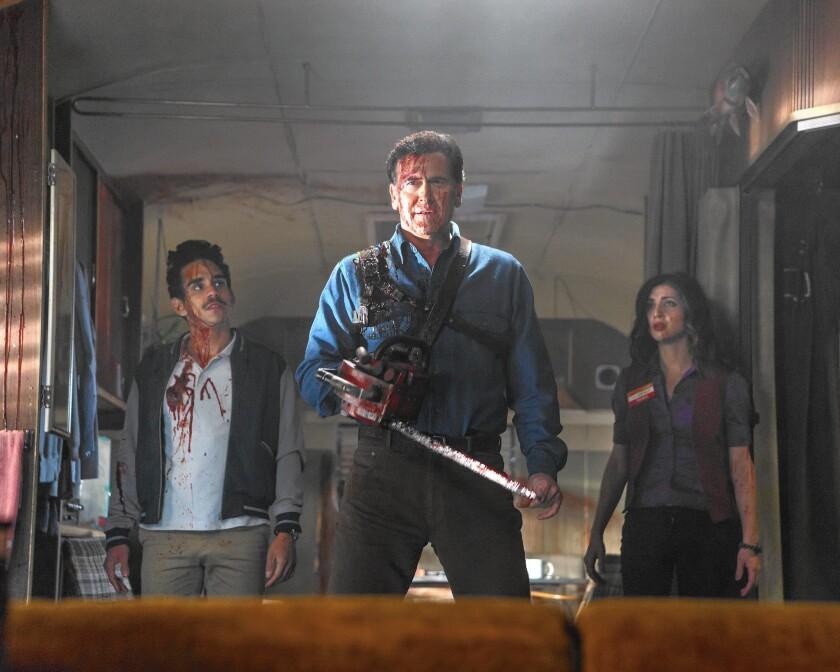 "Ray Santiago (as Pablo), left, Bruce Campbell (Ash) and Dana DeLorenzo (Kelly) in Starz's ""Ash vs Evil Dead."""