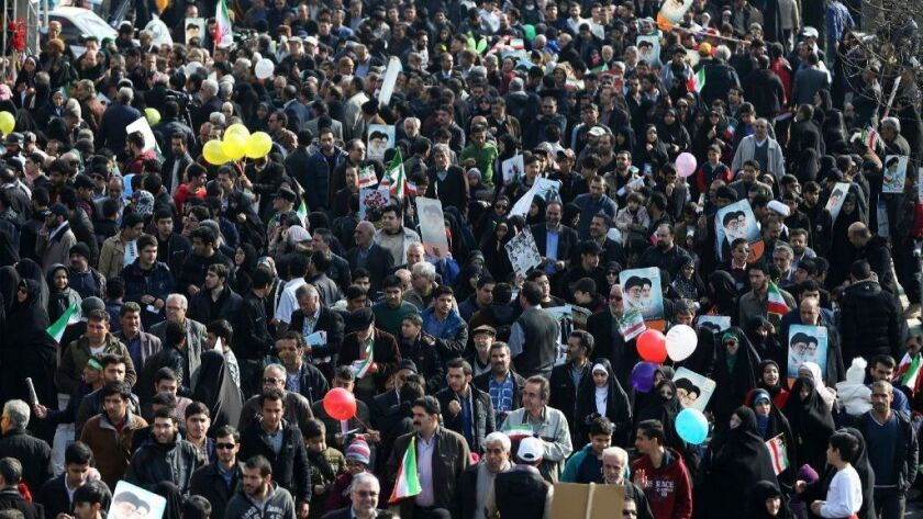 Iranians attend a rally marking the 39th anniversary of the 1979 Islamic Revolution, in Tehran on Sunday, Feb. 11, 2018.