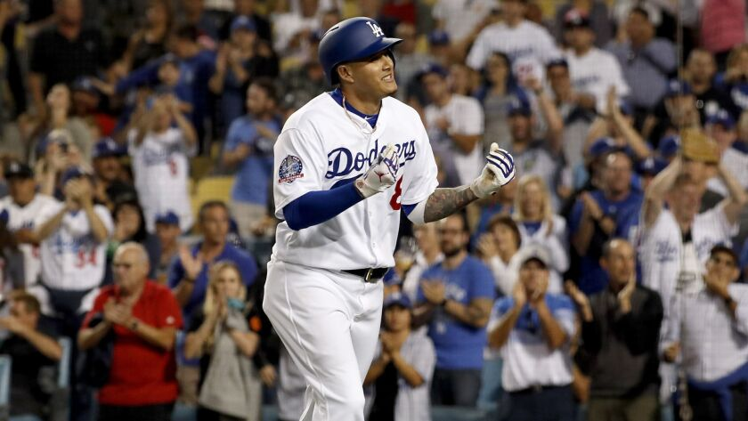 LOS ANGELES, CALIF. - AUG. 30, 2018. Dodgers shortstop Manny Machado gestures to the crowd after h