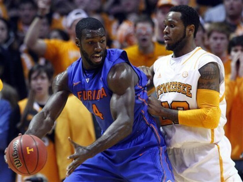 Florida center Patric Young (4) works against Tennessee forward Kenny Hall (20) in the first half of an NCAA college basketball game on Tuesday, Feb. 26, 2013, in Knoxville, Tenn. (AP Photo/Wade Payne)