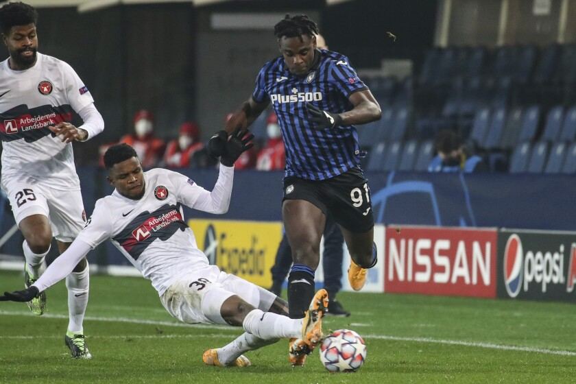 Midtjylland's Frank Onyeka (38) competes for the ball against Atalanta's Duvan Zapata during their Group D, Champions League soccer match between Atalanta and FC Midtjylland, at the Geweiss stadium in Bergamo, Italy, Tuesday, Dec. 1, 2020. (Stefano Nicoli/LaPresse via AP)