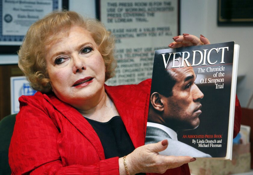 "In this Thursday, Dec. 11, 2014 photo, Associated Press special correspondent Linda Deutsch holds a copy of her book, ""Verdict, The Chronicle of the O.J. Simpson Trial,"" at her home in Los Angeles. Deutsch, who wraps up a 48-year career with the AP on Monday, Dec. 22, 2014, was a young general assi"