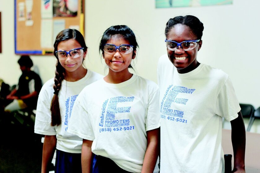Access Youth Academy squash players and program participants Emily, Karen and Djulia