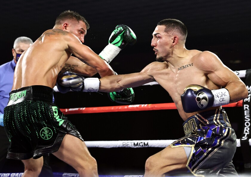 Teofimo Lopez, right, reaches to punch Vasiliy Lomachenko in a lightweight boxing match Oct. 17, 2020.