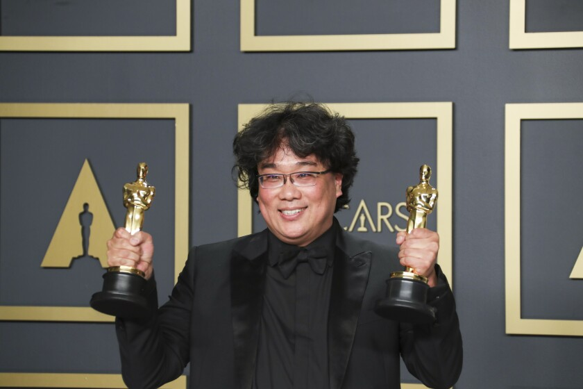 Bong Joon Ho with two of his Oscars.