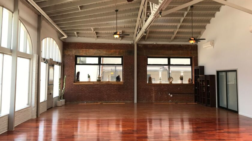Mandala yoga studio features high ceilings and glossy floors.