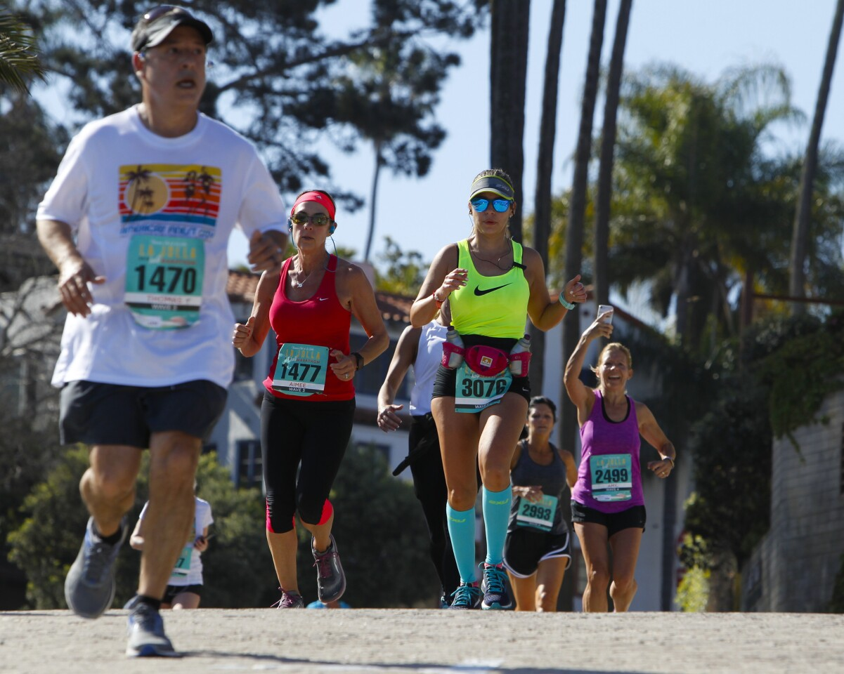 Runners make their way down the last stretch heading for the finish line for the La Jolla Half Marathon on Sunday.