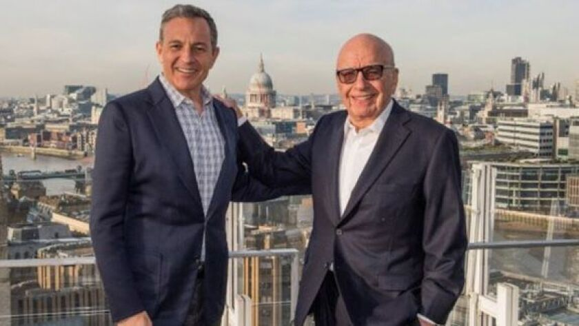 Bob Iger, left, chief executive of Walt Disney Co., and Fox Chairman Rupert Murdoch celebrate in London in December after announcing Disney's $52.4-billion proposal to acquire much of Fox.