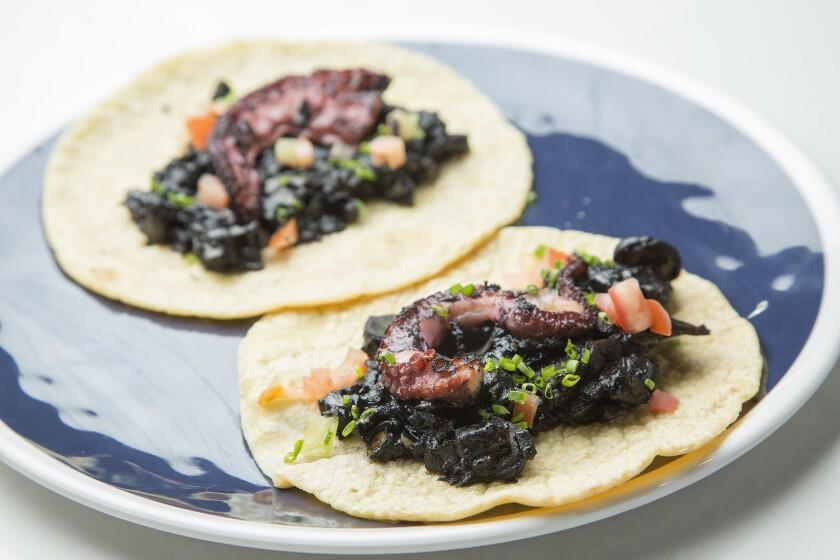 The Yucatán-style seafood menu at Gilberto Cetina Jr.'s Holbox in Mercado La Paloma includes octopus tacos.