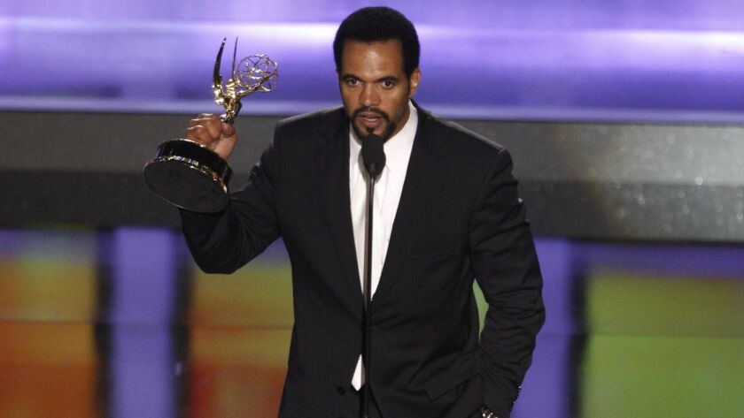 """Kristoff St. John accepts the award for outstanding supporting actor in a drama series for his work on """"The Young and the Restless"""" at the 35th Annual Daytime Emmy Awards in Los Angeles."""