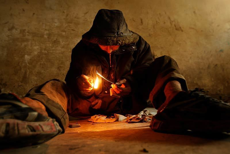 Mohammed Jawad Rezaie smokes heroin in an abandoned building in Kabul where addicts gather. Officials say as many as a million Afghans use narcotics. Rick Loomis / Los Angeles Times