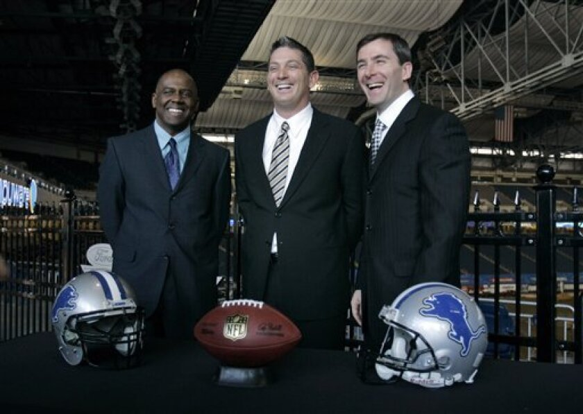 Detroit Lions new head coach Jim Schwartz, center, stands with Lions General Manager' Martin Mayhew, left, and team president Tom Lewand at a news conference at Ford Field in Detroit, Friday, Jan. 16, 2009. Schwartz is faced with the gargantuan task of turning around the NFL's worst team.   (AP Pho