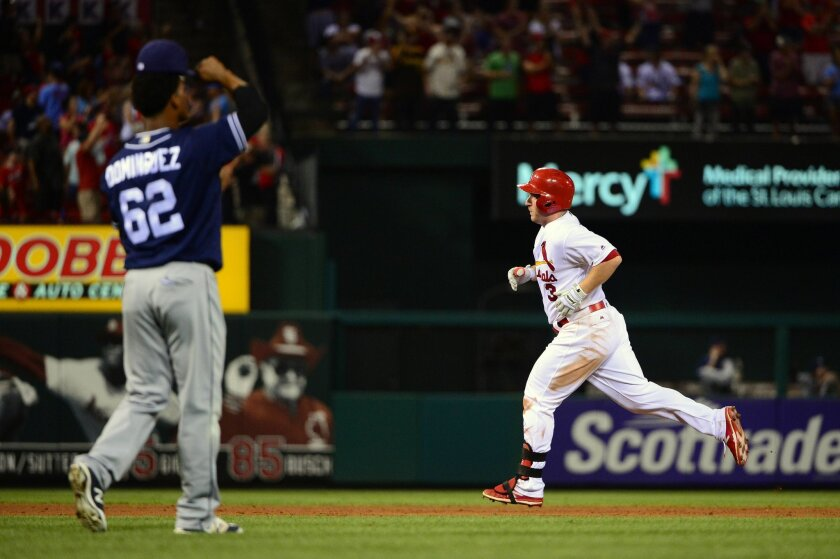 St. Louis Cardinals second baseman Jedd Gyorko (3) runs the bases after hitting a two run home run off of San Diego Padres relief pitcher Jose Dominguez (62) during the seventh inning at Busch Stadium.