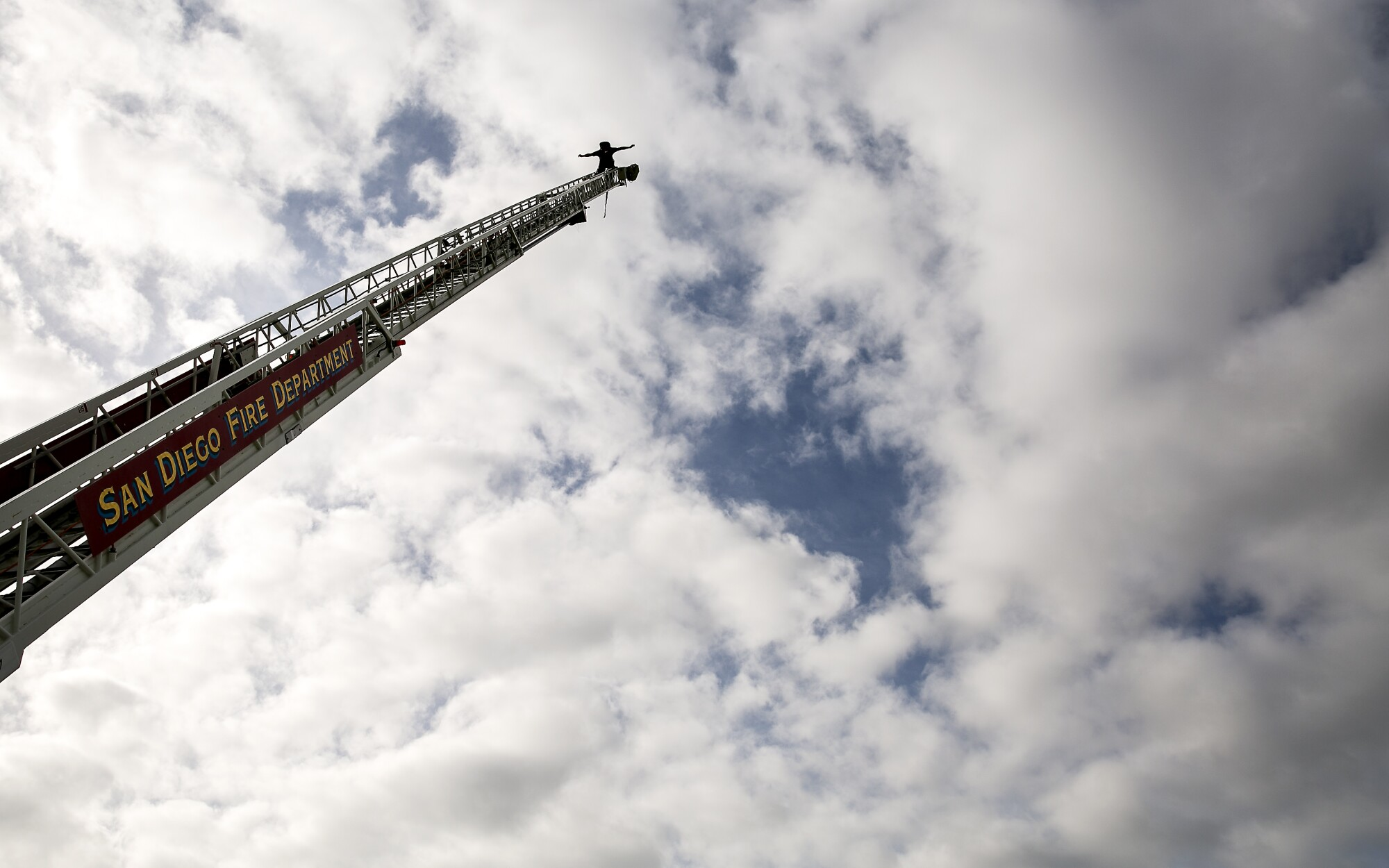 "Recruits in the San Diego Fire-Rescue Department's 87th academy must scale a 105-foot ladder that's set at a 60-degree angle on the back of a fire truck. When they reach the top, they have to lean back -- ""trust your equipment,"" an instructor tells them repeatedly -- and shout their academy's motto: ""With Pride We Fight!"""