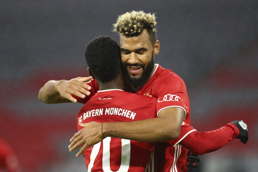 Bayern's Eric Maxim Choupo-Moting, right, celebrates after scoring his side's first goal during the 1st round German Soccer Cup match between FC Bayern Munich and FC Duren, at the Allianz Arena in Munich, Germany, Thursday, Oct. 15, 2020. (AP Photo/Matthias Schrader)