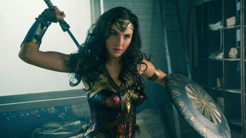 "Gal Gadot in a scene from the film ""Wonder Woman."" The character's sword, tiara and other props will be on display at the Warner Bros. Studio Tour in Burbank starting July 31."