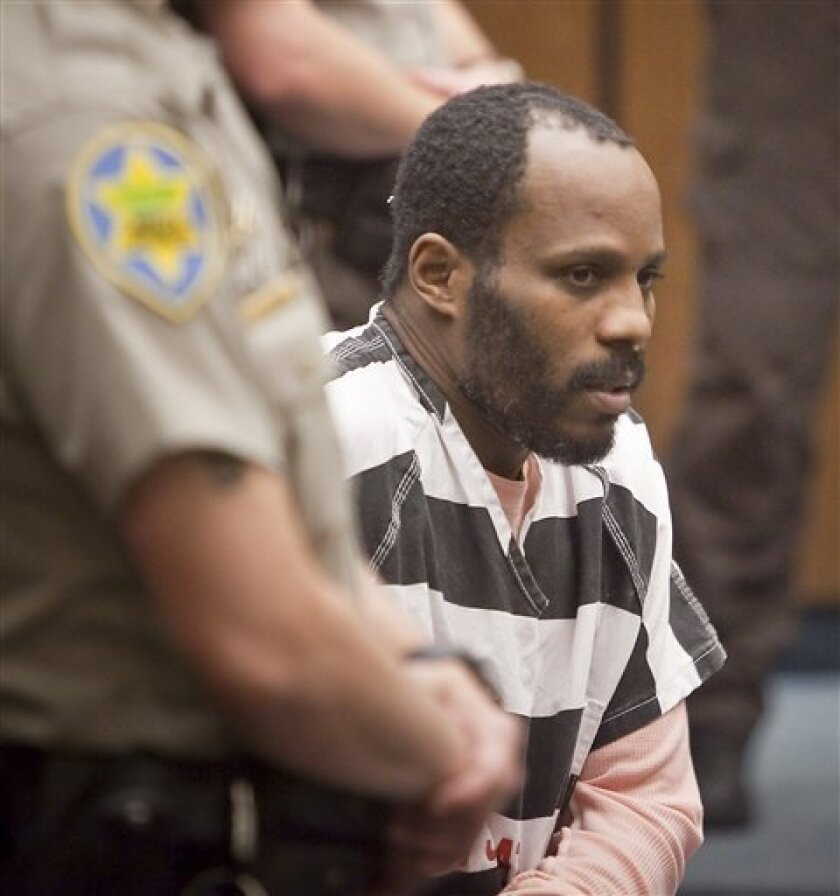 Rapper DMX, whose real name is Earl Simmons, 38, listens to the proceedings in the courtroom, Friday, Jan 30, 2009, in Phoenix. DMX has been sentenced to serve 90 days in jail. Simmons pleaded guilty in December to one felony count of theft, one count each of felony possession of marijuana and a na