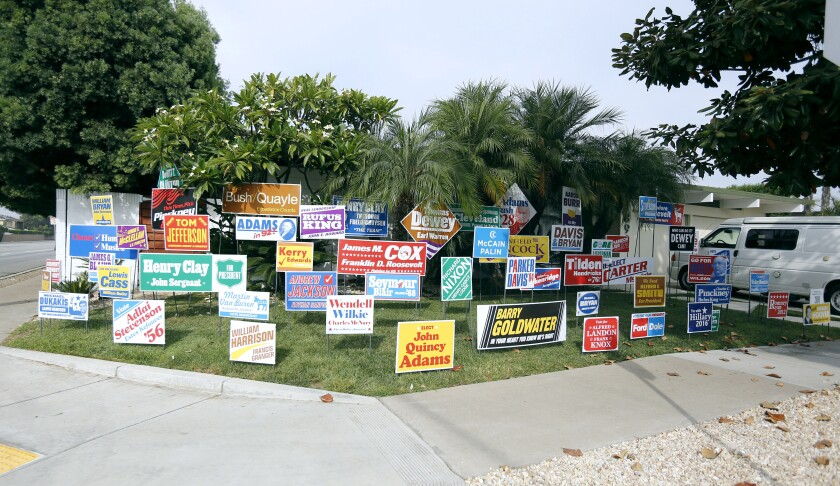 """Signs put up for the """"Monument to the Unelected"""" art installation by Nina Katchadourian"""