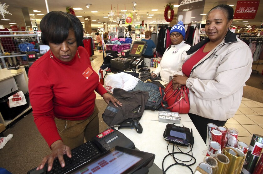 J.C. Penney worker Wanda Cofield, left, assists Cynthia Putney, right, and Linda Pierce on Dec. 26 in Rocky Mount, N.C. Holiday sales rose to $691.9 billion in November and December, a 5.5 percent increase from the prior year, according to the National Retail Federation.