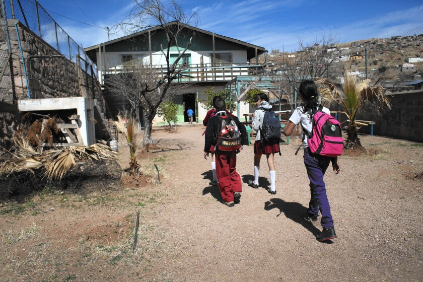 Schoolchildren arrive for lunch at a kitchen run by Home of Hope and Peace, a nonprofit group, in Nogales, Mexico. To attend school in Mexico, students must have proper documents, which many U.S.-born children of returning Mexicans lack.