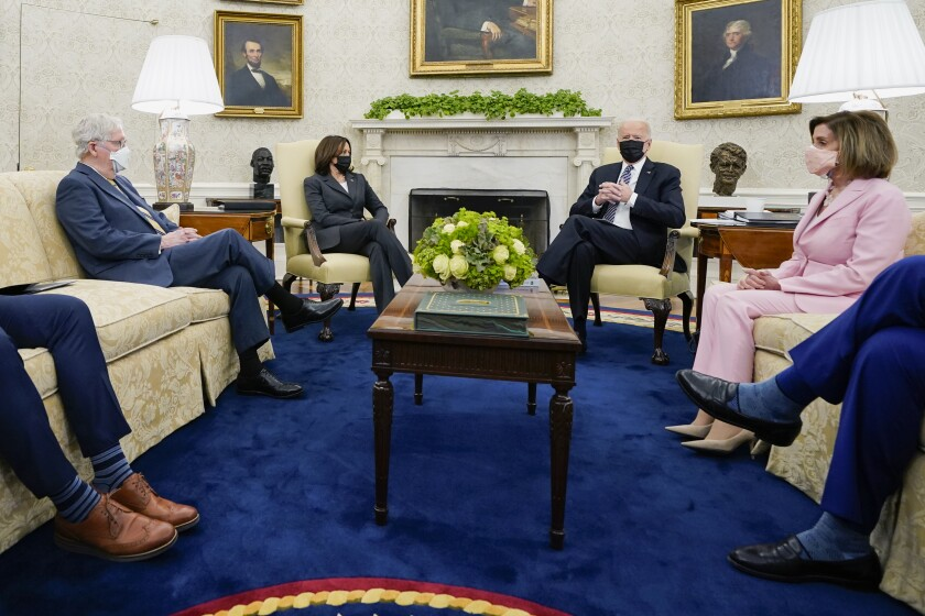 FILE - In this May 12, 2021, file photo President Joe Biden speaks during a meeting with congressional leaders in the Oval Office of the White House in Washington. From left, House Minority Leader Kevin McCarthy of Calif., Senate Minority Leader Mitch McConnell of Ky., Vice President Kamala, Biden, House Speaker Nancy Pelosi of Calif., and Senate Majority Leader Chuck Schumer of N.Y. Congress is hunkered down, grinding through an eight-week stretch as the president's Democratic allies in the House and Senate try to shape his big infrastructure ideas into bills that could actually be signed into law. Perhaps not since the drafting of Obamacare more than a decade ago has Washington tried a legislative lift as heavy as this. (AP Photo/Evan Vucci, File)