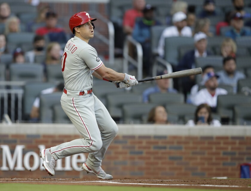Philadelphia Phillies' J.T. Realmuto watches his double off Atlanta Braves pitcher Ian Anderson in the first inning of a baseball game Saturday, May 8, 2021, in Atlanta. (AP Photo/Ben Margot)