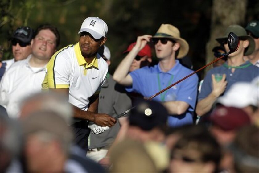 Tiger Woods watches his tee shot on the 15th hole during the second round of the Masters golf tournament Friday, April 12, 2013, in Augusta, Ga. (AP Photo/Darron Cummings)