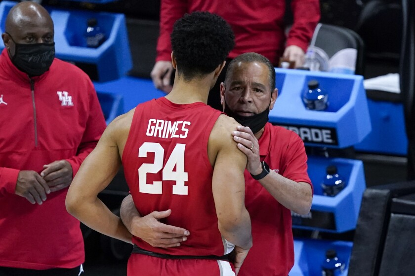 Houston guard Quentin Grimes (24) gets a hug from head coach Kelvin Sampson at the end of a men's Final Four NCAA college basketball tournament semifinal game against Baylor, Saturday, April 3, 2021, at Lucas Oil Stadium in Indianapolis. (AP Photo/Darron Cummings)