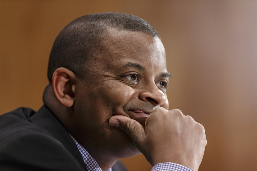 FILE - In this March 13, 2014 file photo, Transportation Secretary Anthony Foxx is shown during testimony before the Senate Transportation subcommittee on Capitol Hill in Washington. Foxx says the government has opened a price-gouging investigation involving four airlines that allegedly raised airfares in the Northeast after an Amtrak crash in Philadelphia in May disrupted rail service. (AP Photo/J. Scott Applewhite)