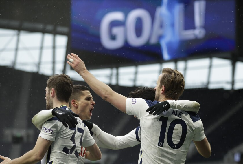 Tottenham's Harry Kane celebrates with teammates after scoring his side's opening goal during the English Premier League soccer match between Tottenham Hotspur and West Bromwich Albion at the Tottenham Hotspur Stadium in London, Sunday, Feb. 7, 2021. (AP Photo/Matt Dunham, Pool)