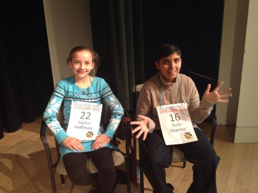 Sophia Hoffman, 11, and Kush Sharma, 13, remain tied after more than 60 rounds of spelling at the Jackson County Spelling Bee in Kansas City, Mo.
