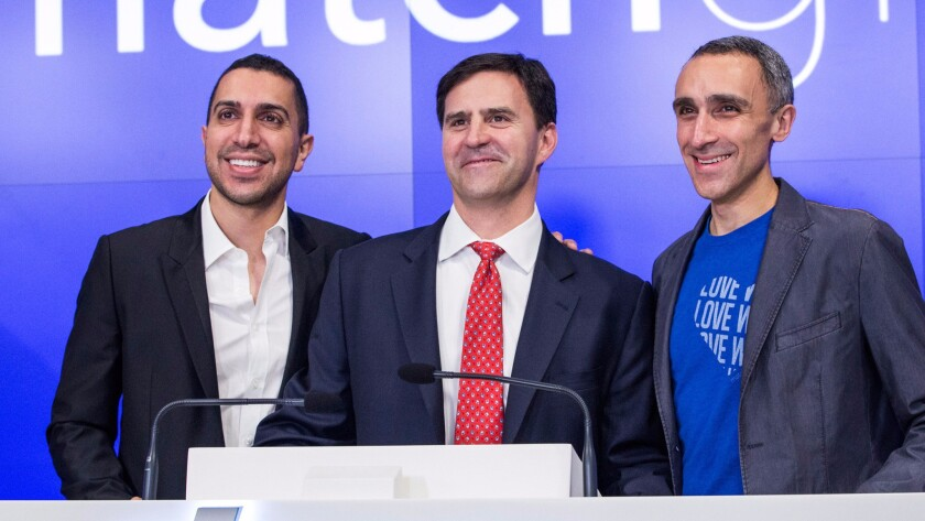 Tinder Chief Executive Sean Rad, left, with two of the company's board members, Greg Blatt and Sam Yagan.