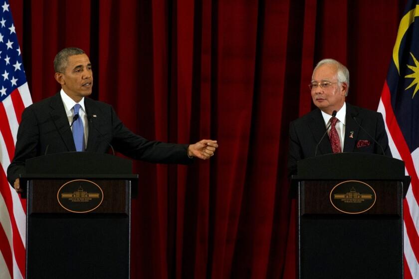 President Obama and Malaysian Prime Minister Najib Razak hold a news conference Sunday outside Kuala Lumpur.