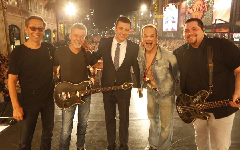 "Van Halen performed a special concert for ABC's ""Jimmy Kimmel Live"" on March 30 on Hollywood Boulevard. From left, Alex Van Halen, Eddie Van Halen, Jimmy Kimmetl, David Lee Roth and Wolfgang Van Halen"
